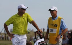 Stewart Cink talks to his caddie on the 11th hole during the Open Championship in England.