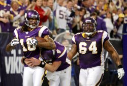 Vikings' Farve, Rice and Herrera celebrate touchdown against the Cowboys in Minneapolis