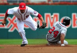 Atlanta Braves Michael Bourn steals second in Washington