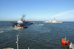 The U.S. Navy moves ships out to sea in preparation of Hurricane Irene