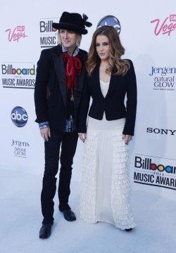 Lisa Marie Presley and Michael Lockwood arrive at the 2012 Billboard Music Awards in Las Vegas, Nevada