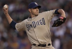 Padres Pitcher Garland Pitches Against the Rockies in Denver