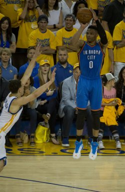 Thunder's Russell Westbrook takes a three against the Golden State Warriors