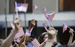Fans hold up American Flags as Rachel Platten performs