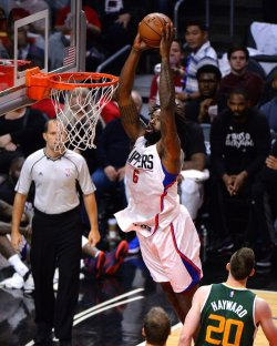 Clippers' center De'Andre Jordan dunks the ball in Los Angeles