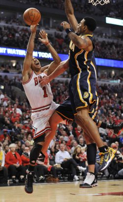 Bulls Rose fouled by Pacers Foster and Rush in Chicago