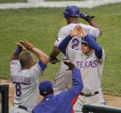 Rangers Kinsler congratulated after scoring against Tigers in game 5 of ALCS in Detroit, Michigan