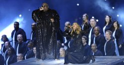 Madonna and Cee Lo Green perform during halftime of the Super Bowl