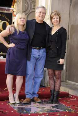 Alan Menken poses with wife Janis and daughter Anna Rose after he receives a star on the Hollywood Walk of Fame