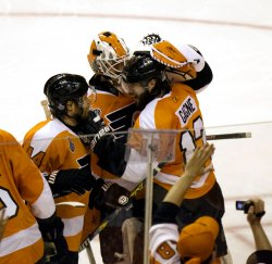 The Flyers celebrate after winning game three of the 2010 Stanley Cup Final