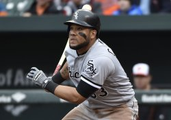 White Sox Melky Cabrera hits an RBI single against the Baltimore Orioles