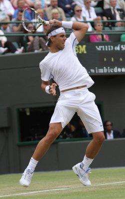 Rafael Nadal returns at Wimbledon.