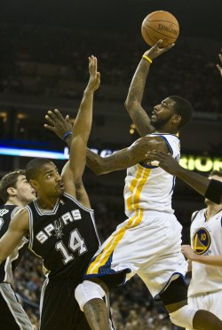 Warriors Dorell Wright puts up a shot over San Antonio Spurs Gary Neal in Oakland, California