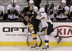 Penguins Asham checks Bruins Boychuk at TD Garden in Boston, MA.