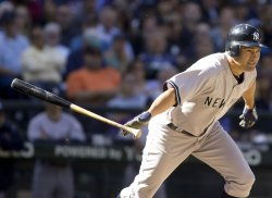 New York Yankees' Johnny Damon hits a line drive.