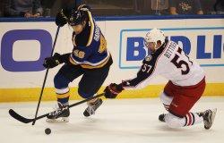 Columbus Blue Jackets Paul Bittner uses stick to slow St. Louis Blues Ivan Barbashev