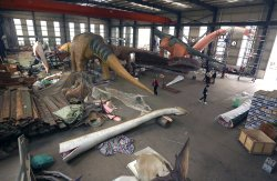 Chinese workers assemble large robotic dinosaurs in Zigong, China