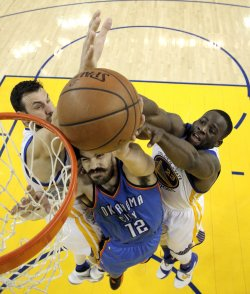 Warriors Bogut and Green defend against a shot by Thunder's Adams