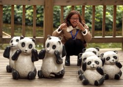 A Chinese woman poses for photos at the panda center in Chengdu, China
