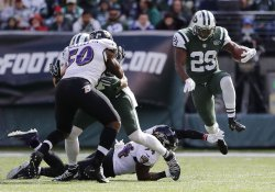 Jets Ryan Bilal Powell leaps as he carries the football