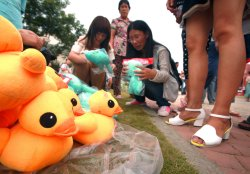A Chinese woman sells stuffed animals in Qingdao