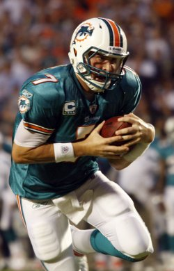 Dolphins Chad Henne scores in Miami.
