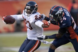 Bears Hester Grabs Broncos Bailey's Facemask in Denver