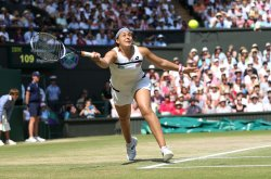 Marion Bartoli returns in the 2013 Wimbledon Women's Final match against Sabine Lisicki