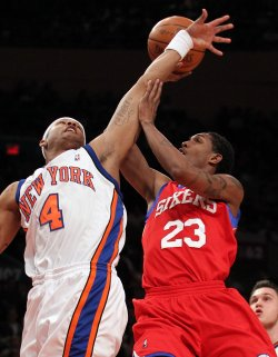New York Knicks J.R. Giddens tries to block a shot from Philadelphia 76ers Louis Williams at Madison Square Garden