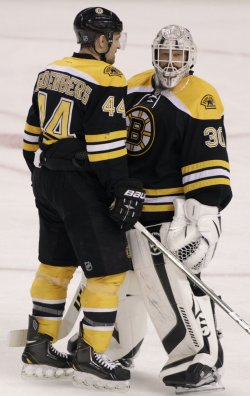 Bruins Seidenberg and Thomas chat at TD Garden in Boston, MA.