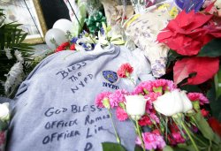 Memorials for two NYPD police officers killed in New York