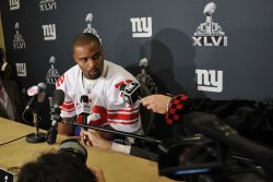 New York Giants' Osi Umenyiora speaks at a press conference in Indianapolis