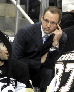 Penguins Head Coach Dan Bylsma Watches Second Period Action in Pittsburgh