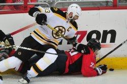 Bruins Zdeno Chara pushes Washington Capitals Brooks Laich to the ice in Washington