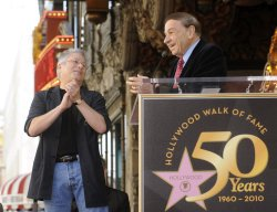 Alan Menken is introduced by Richard Sherman before he receives a star on the Hollywood Walk of Fame