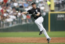 Chicago White Sox second baseman Chris Getz throws to first base against the Boston Red Sox in Chicago