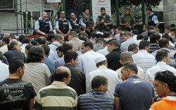 Muslims pray after being denied entry to the Temple Mount