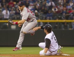 Cardinals Schumaker Forces Rockies Stewart in Denver