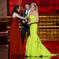 Julie Bowen, Kat Dennings and Jon Cryer attend the 64th Primetime Emmy Awards in Los Angeles