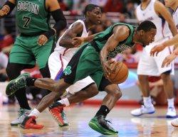 Los Angeles Clippers DeAndre Jordan dunks over Boston Celtics in Los Angeles