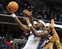 Washington Wizards' Andray Blatche drives to the basket in Washington