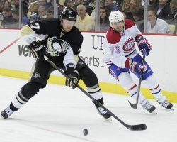 Penguins Martin Clears Puck Away from Montreal's Ryder in Pittsburgh