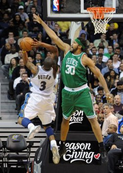 Wizards Butler fouled by Celtics Wallace in Washington