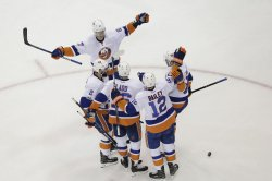 New York Islanders Andrew Ladd reacts after a goal