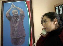 A POSTER OF MARWAN BARGHOUTI HANGS IN HIS IN RAMALLAH OFFICE