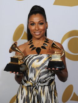 Melanie Fiona Holds Grammys at the 54th annual Grammy Awards at the Staples Center in Los Angeles