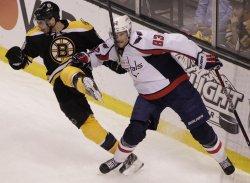 Capitals Beagle checks Bruins Krejci at TD Garden in Boston, MA.