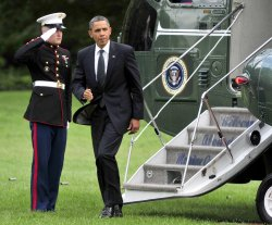Obama Returns from Michigan to White House