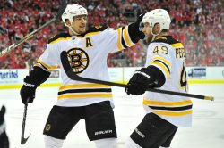 Bruins Patrice Bergeron celebrates with Rich Peverley in Washington
