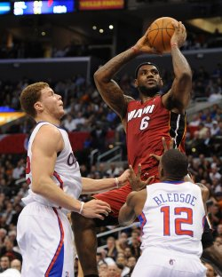 LeBron James scores over Clippers